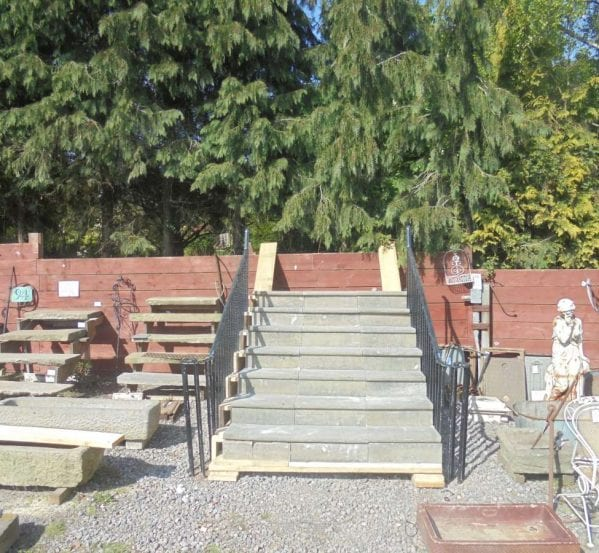 A reclaimed set of York Stone steps and cast iron railings