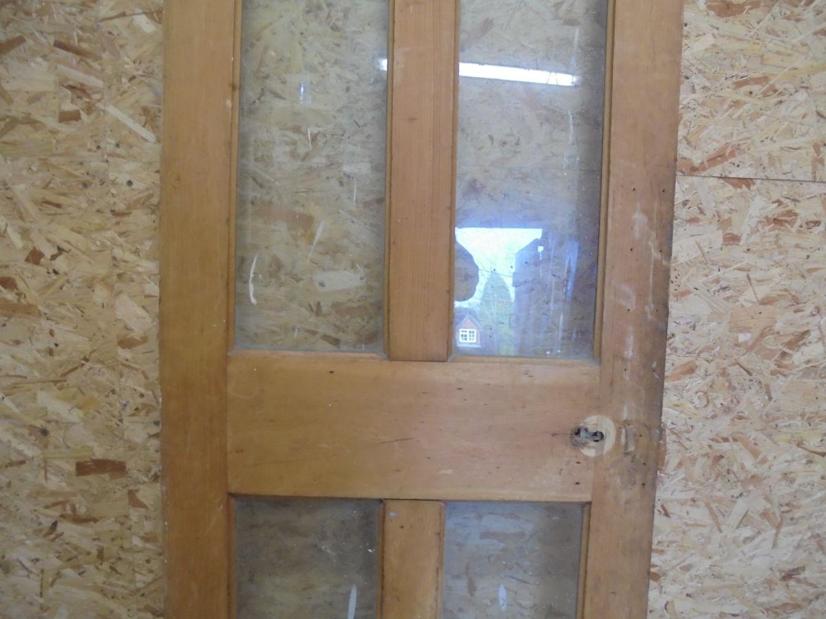 Stripped 4 Panelled Glazed Door