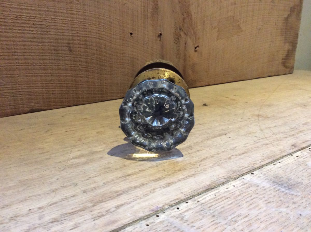 Clear Glass and Brass Door Knobs