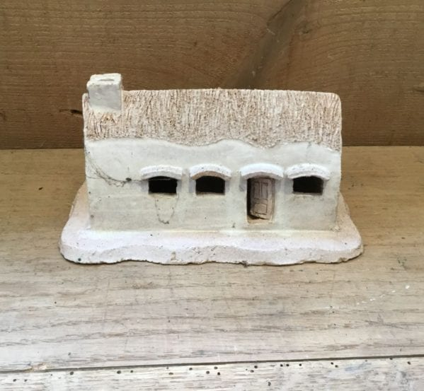 Small White Pottery Cottage