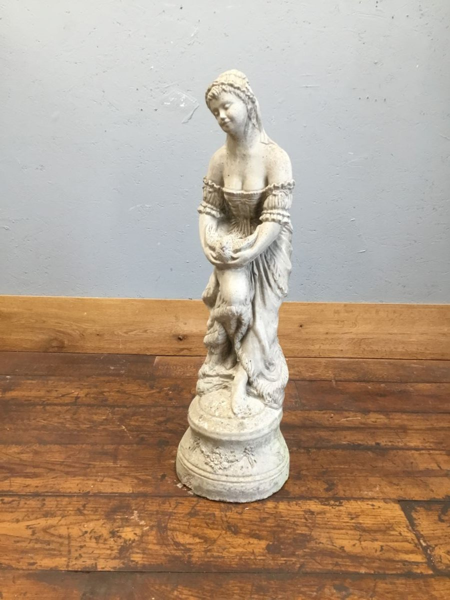 Reconstituted Lady Holding Bird Statue