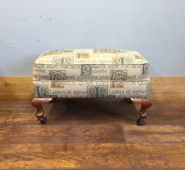 Upholstered Foot Stool On Castors
