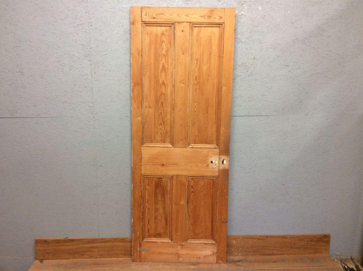 Stripped Medium Tone Four Panel Door