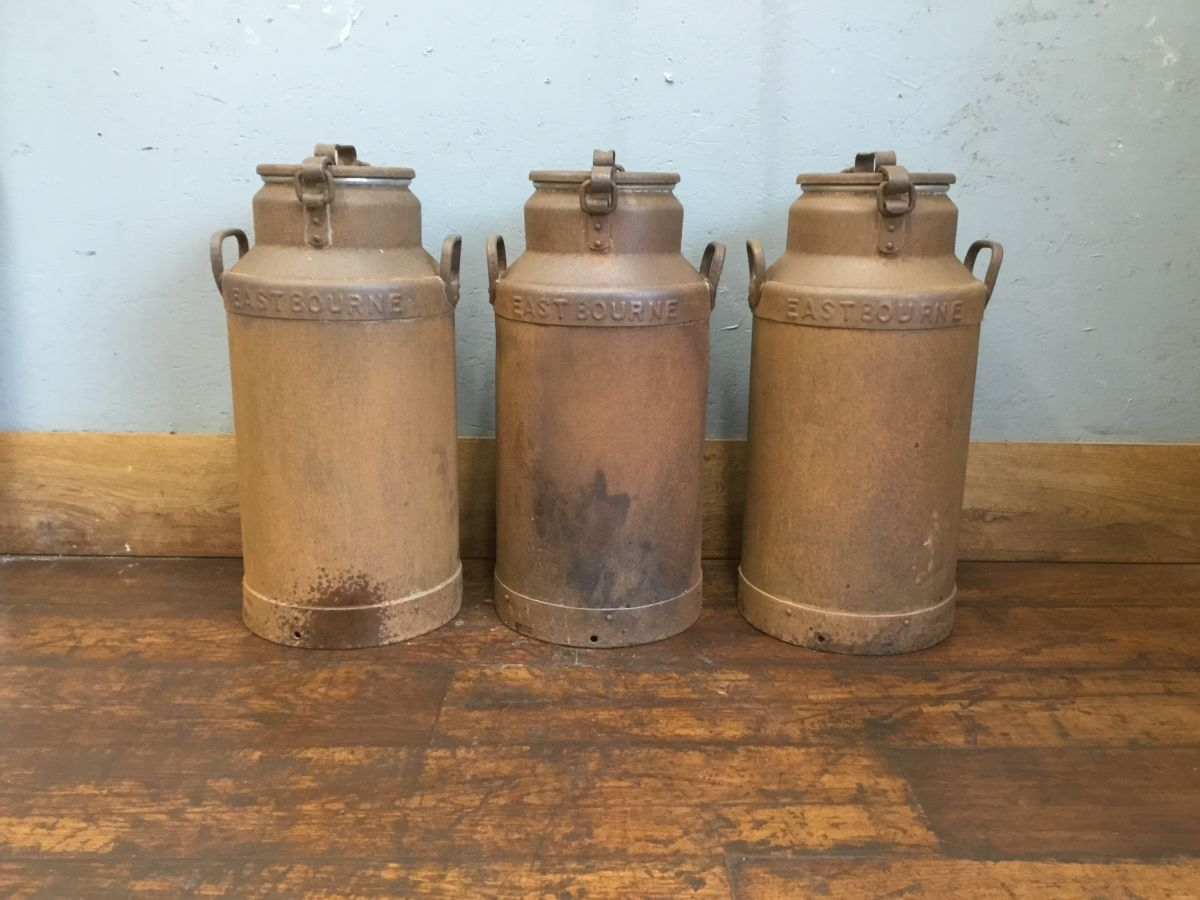 Three Large Milk Churns