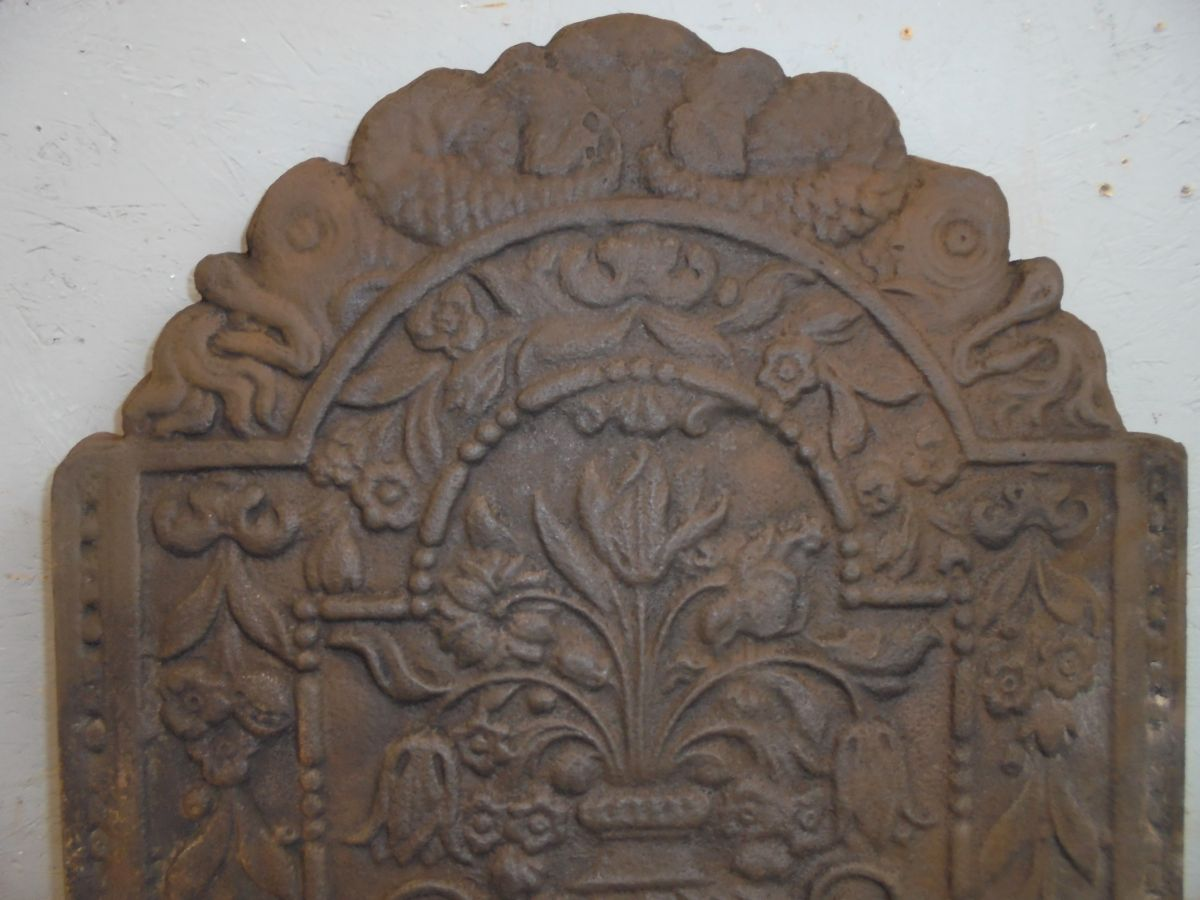 Cast Iron Fire Back with Vase and Flowers