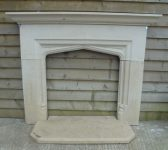 Carved stone fire surround