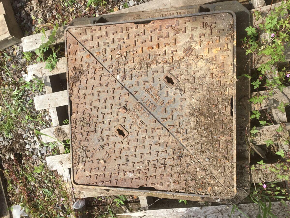 Reclaimed Watt Man Hole Cover